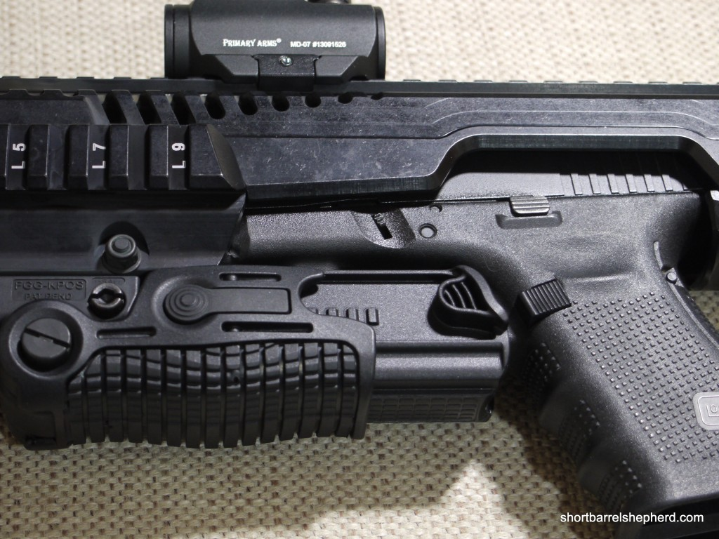 The foregrip's bottom extends to cover the trigger guard