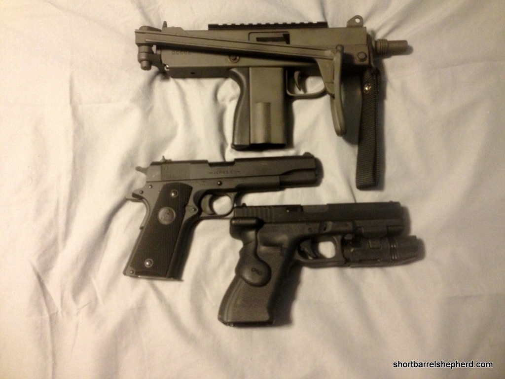 The MAC 10 next to a 1911 and a Glock 17
